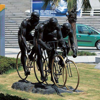 铸铜骑自行车人物雕塑